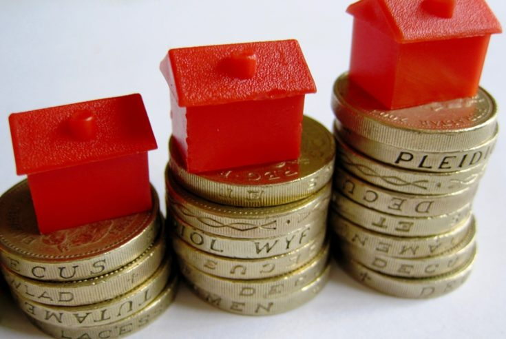 house_prices-UK-high-in-july-mini-boom-red-houses-on-money-HOUSING-MARKET